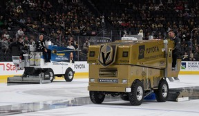 Chris Cotsilis (R) operates an ice resurfacer before a game between the Calgary Flames and the Vegas Golden Knights at T-Mobile Arena on October 12, 2019 in Las Vegas, Nevada.  (Photo by Ethan Miller/Getty Images)
