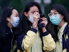 High school students wear protective face masks to protect themselves from coronavirus disease (COVID-19) while taking photos of the flag rising ceremony at Chiang Kai Shek Memorial Hall in Taipei, Taiwan, March 11, 2020. REUTERS/Ann Wang ORG XMIT: GGGTW04