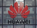 In this file photo taken on April 29, 2019, the Huawei logo and signage is seen at their main U.K. offices in Reading, west of London.