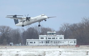 A Porter Airlines plane takes off from Billy Bishop island airport.