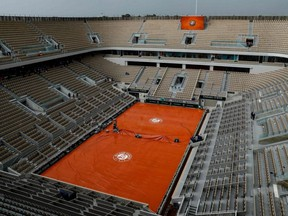 This file photo taken on June 4, 2019, shows a general view of the empty Philippe Chatrier court during rain, at the French Open in Paris.