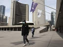 Pedestrians pass through Nathan Phillips Square in front of Toronto City Hall on Monday.