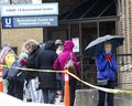 People wait in line to enter the COVID-19 Assessment Centre  at Sunnybrook Hospital in Toronto on Tuesday March 17, 2020. Stan Behal/Toronto Sun