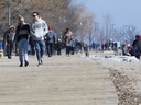 Torontonians enjoy a Friday afternoon in The Beach despite government calls for social distancing.  Friday, March 27, 2020. (Stan Behal/Toronto Sun/Postmedia Network)