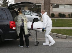 A body is removed from the Eatonville Care Centre long-term facility in Etobicoke which has experienced a COVID-19 outbreak.