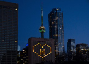 Lights in the rooms of the Hilton Hotel in Toronto are lit to honour front line health care workers on Sunday April 5, 2020.