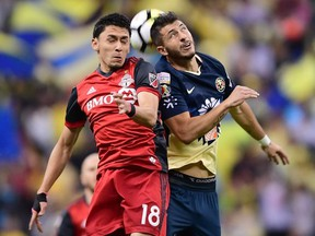 Marky Delgado, left, has signed a long-term contract with TFC. Getty images