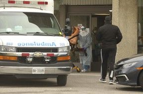 A resident is removed from the Eatonville Care Centre in Etobicoke around 3 p.m. Friday and transported via Toronto ambulance to hospital. The centre's death toll is at 39.