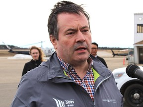 Alberta Premier Jason Kenney speaks to media outside the Executive Flight Centre in Fort McMurray, Alta., on Monday, April 27, 2020.