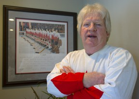 Pat Stapleton stans next to a photo of Team Canada at the 1972 Summit Series in 2010.. Mike Hensen/Postmedia files
