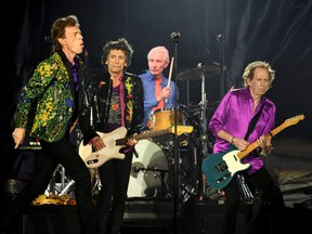 From left to right, Mick Jagger, Ronnie Wood, Charlie Watts and Keith Richards of The Rolling Stones perform onstage at Rose Bowl in Pasadena, Calif., Aug. 22, 2019.