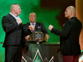 WWE champion Brock Lesnar (left) and former UFC heavyweight champion Cain Velasquez face off as Lesnar's advocate Paul Heyman looks on at T-Mobile Arena on October 11, 2019 in Las Vegas. (Ethan Miller/Getty Images)