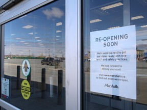 A sign posted at the entrance to Marshalls on Marcus Drive in Sudbury, Ont. on Friday May 15, 2020, said the store will reopen soon. The Government of Ontario said effective May 19, retail stores with dedicated street access can open as long as the business adheres to guidelines issued by the provincial government.