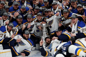 St. Louis Blues players pose for a team photo with the Stanley Cup after defeating the Boston Bruins in game seven of the 2019 Stanley Cup Final at TD Garden.