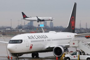 An Air Canada Boeing 737 MAX 8 from San Francisco approaches for landing at Toronto Pearson International Airport over a parked Air Canada Boeing 737 MAX 8 aircraft in Toronto.