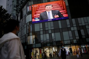 A giant screen on the facade of a shopping mall shows news footage of Chinese President Xi Jinping at the closing session of the National People's Congress (NPC), in Beijing, China May 28, 2020.
