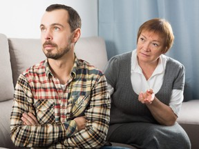 Aged mother argues with her adult son at home.