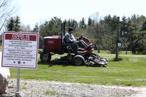 The maintenance crew prepares Carruthers Creek Golf & Country Club for opening on Wednesday, May 13, 2020.
