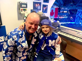 Six-year-old busker Max keys with Maple Leafs organist Jimmy Holmstrom.