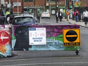 Active TO program on Kensington in  Kensington Market area restricting traffic in an attempt  to provide more space for people on this Victoria Day weekend.  Friday May 15, 2020.