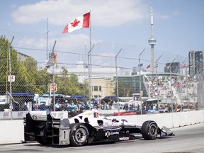 French driver Simon Pagenaud takes a turn on the way to taking pole position during the qualifying session for the Honda Indy Toronto on Saturday, July 15, 2017.