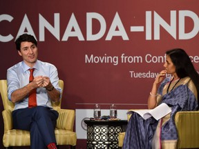 Prime Minister Justin Trudeau (lefg) speaks during a business summit in Mumbai on Feb. 20, 2018.