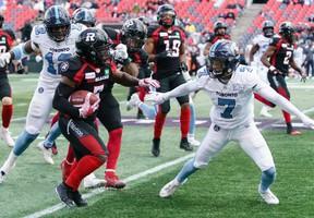 As a defensive back who has lined up in virtually every position in the secondary, Argos' Robert Woodson (right) is the longest-tenured Canadian in the back end.Jana Chytilova photo
