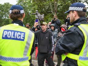 Police officers are seen next to right wing protesters in Parliament Square on June 12, 2020 in London, United Kingdom.