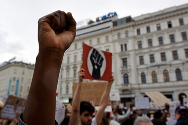 A protester raises a fist during a Black Lives Matter march on June 04, 2020 in Vienna, Austria. The death of an African-American man, George Floyd, while in the custody of Minneapolis police has sparked protests across the United States, as well as demonstrations of solidarity in many countries around the world.