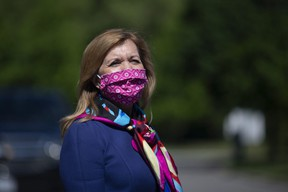Ontario Health Minister Christine Elliott attends a photo opportunity in which she joined Premier Doug Ford in handing out bagged gifts from Prince Edward Island for health-care workers at Birchmount Hospital in Toronto on Monday, June 8, 2020.