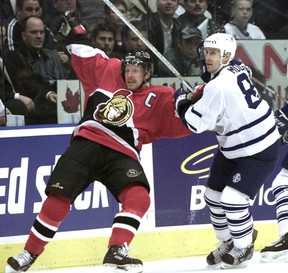 Former rivals Daniel Alfredsson (left) and Alexander Mogilny, seen here battling in the playoffs while with Ottawa and Toronto, respectively, are two of the players believed to be on the bubble for hockey hall of fame selection this year. Jarome Iginla is regarded as a shoo-in.