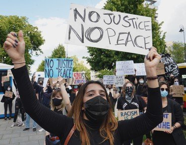 Demonstrators protest with banners against racism in front of the US embassy in Warsaw on June 4, 2020 in solidarity with protests raging across the United States over the death of George Floyd.