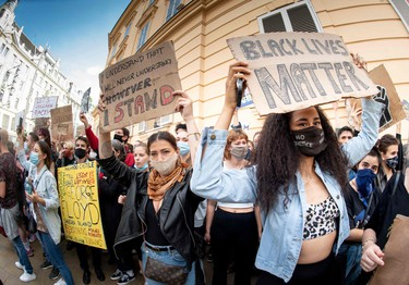 Protestors attend a Black Lives Matter march in Vienna, Austria, on June 4, 2020, in solidarity with protests raging across the United States over the death of George Floyd, an unarmed black man who died during an arrest on May 25.