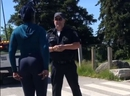 A still of an exchange between a woman and a Toronto bylaw officer at Centennial Park in Etobicoke on Tuesday, June 16 2020,