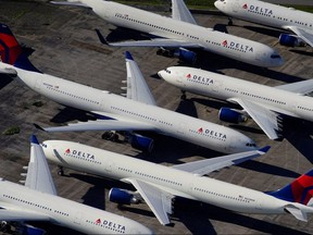 Delta planes are seen parked due to flight reductions made to slow the spread of coronavirus disease at Birmingham-Shuttlesworth International Airport in Birmingham, Alabama, March 25, 2020.