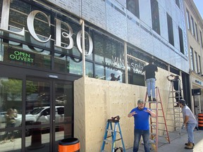 An LCBO location on Queen St. W. near Bathurst St. in Toronto is boarded up Thursday, June 4, 2020 ahead of weekend protests.