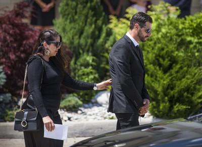Michael Ciasullo, joined by his sister Connie Ciasullo - as they leave the funeral of his wife and children - Karolina, Klara, Lilianna and Mila Ciasullo  - at St. Eugene de Mazenod Catholic Church  in Brampton, Ont. on Thursday June 25, 2020.  The family members were killed in a tragic collision in Brampton on June 18. Ernest Doroszuk/Toronto Sun/Postmedia