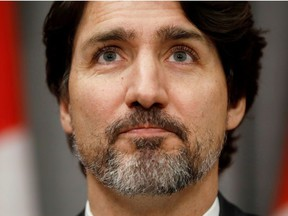 Canada's Prime Minister Justin Trudeau pauses during a news conference on Parliament Hill in Ottawa, Ontario, Canada May 1, 2020.