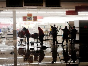 Looters walk through a destroyed K Mart during demonstrations in reaction to the death in Minneapolis police custody of George Floyd in Minneapolis May 30, 2020.