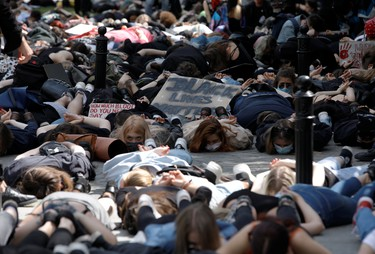 Demonstrators lie on the ground during a protest over police brutality towards African-Americans in the United States, after the death of George Floyd in Minneapolis police custody, in front of the U.S. embassy in Warsaw, Poland, June 4, 2020.