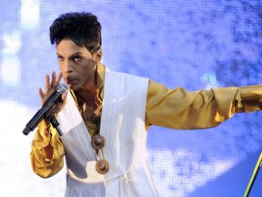 Singer and musician Prince (born Prince Rogers Nelson) performs on stage at the Stade de France in Saint-Denis, outside Paris, on June 30, 2011.