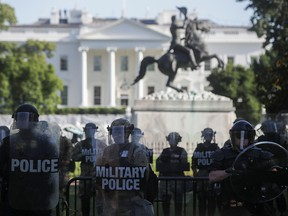 D.C. National Guard military police officers look on as demonstrators rally near the White House against the death in Minneapolis police custody of George Floyd, in Washington, D.C., June 1, 2020.