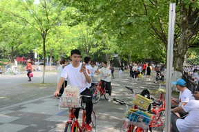 Public bikes are widely used in Hangzhou, China not just for commuting but for exploring public amenities.