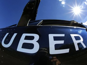 In this Monday, Sept. 12, 2016, file photo, a self-driving Uber sits ready to take journalists for a ride during a media preview in Pittsburgh. The Supreme Court of Canada is set to release a decision Friday morning that could advance the fight to get Uber Technologies Inc. drivers recognized as employees in Canada.
