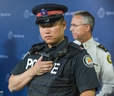 Toronto Police Service  Const. Ben Seto with a body-worn camera during the announcement of the  pilot project at police headquarters in Toronto, Ont.  on Friday May 15, 2015.
