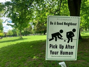 """Signs asking visitors to Trinity Bellwoods Park to """"be a good neighbour"""" and """"pick up after your human"""" recently surfaced in the park after massive crowds gathered two weekends ago. Neighbours reported public urination on their properties because the park washrooms remained closed."""