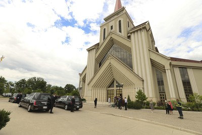 The hearses arrive at the front of St. Eugene De Mazenod Catholic Church in Brampton arrive for the funerals for Karolina Ciasullo and her three daughters Klara, Mila and Lilianna who were killed last Thursday arrive at the church  . Jack Boland/Toronto Sun/Postmedia Network