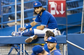 Bo Bichette sits on a dugout railing Jays instrasquad game at the Rogers Centre. Bichette and Rowdy Tellez hit home runs.