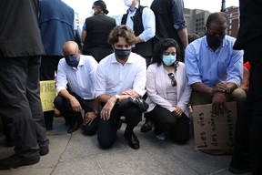Prime Minister Justin Trudeau takes a knee during in a Black Lives Matter protest on Parliament Hill June 5, 2020 in Ottawa. This didn't sit well with the RCMP Veterans' Association.