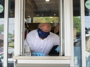 Ontario Premier Doug Ford stands at a window used for take-outs as he visits a bakery in Toronto, on Friday, July 10, 2020. THE CANADIAN PRESS/Chris Young ORG XMIT: chy104